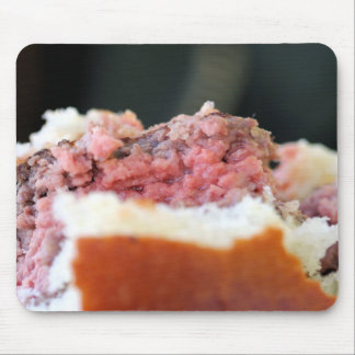 Closeup of the rare meat in a burger mouse pad