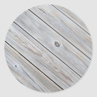 closeup photo of old worn wood deck classic round sticker