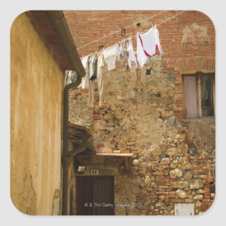 Clothes hanging to dry on a clothesline, square sticker