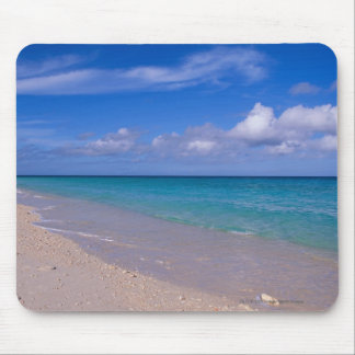 Cloud in blue sky over sandy beach mouse mat