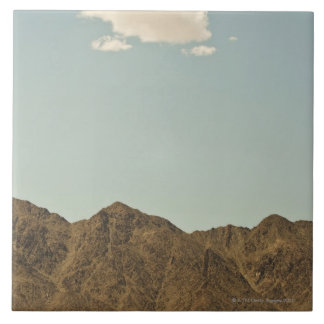 Cloud over Nevada desert and mountains Tile