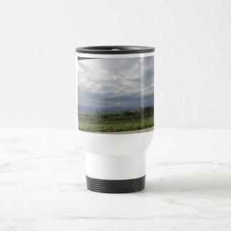 Clouds and field travel mug
