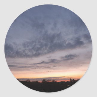 Clouds and sunset colours round sticker