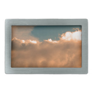 Clouds at sunset belt buckle