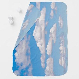 Clouds in blue sky receiving blankets
