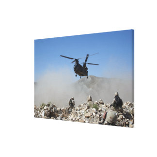 Clouds of dust kicked up by the rotor wash canvas print