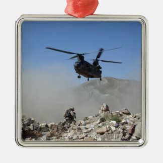 Clouds of dust kicked up by the rotor wash christmas ornament