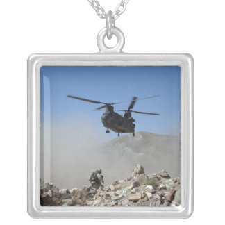 Clouds of dust kicked up by the rotor wash silver plated necklace