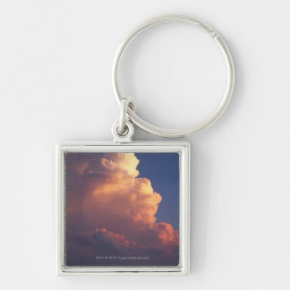 Clouds over sea at sunset key ring