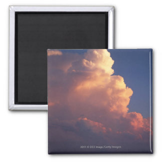 Clouds over sea at sunset magnet