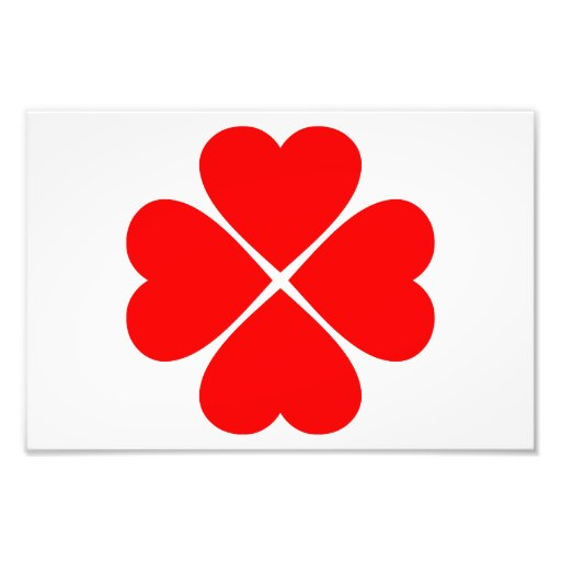 Clover of the luck and the love with red hearts art photo