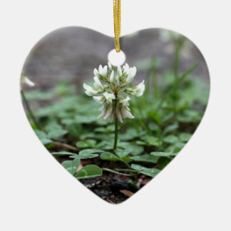 Clover on a tared road. ceramic heart decoration