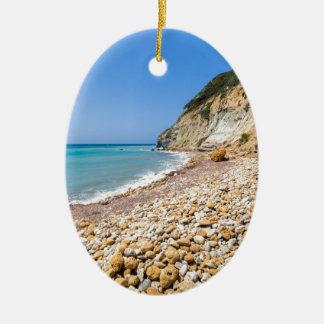 Coast landscape with stony beach and blue sea christmas ornament