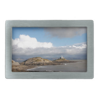 Coastal landscape and lighthouse belt buckle