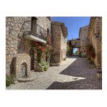Cobblestone street, stone buildings, historic postcards