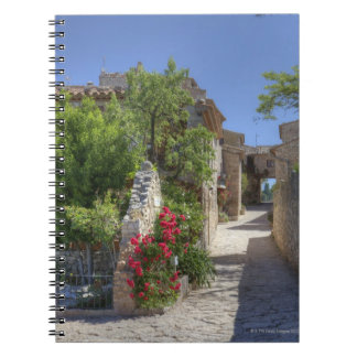 Cobblestone streets, historic stone buildings. notebook