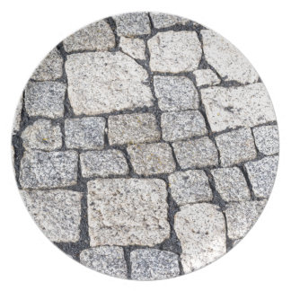 Cobblestones of a street in detail plate