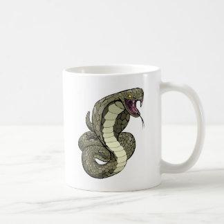 Cobra snake about to strike coffee mugs