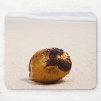 Coconut on a tropical beach mouse pad