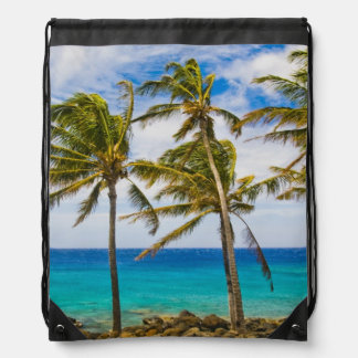 Coconut palm trees (Cocos nucifera) swaying in Drawstring Bag