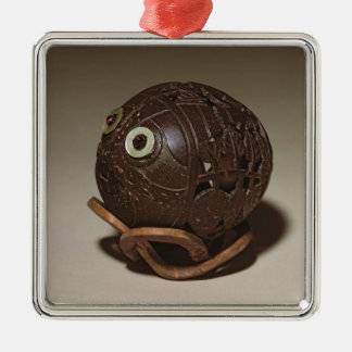 Coconut sculpted into a face, c.1895 christmas ornament