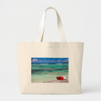 Coconut with tropical flower on exotic coast large tote bag