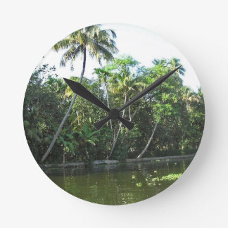 Cocunut and other trees near the saltwater lagoon wallclocks