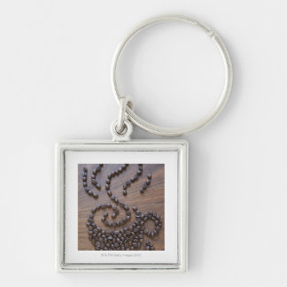 Coffe cup illustrated using coffee beans key ring