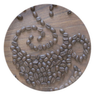 Coffe cup illustrated using coffee beans plate