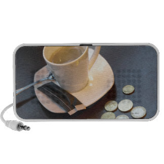 Coffee and money on a table travelling speakers