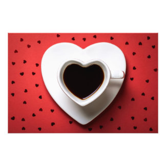 Coffee Cup In Shape Of Heart On Red Paper Photo