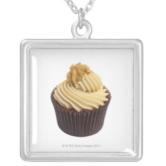 Coffee cupcake topped with coffee cream and a silver plated necklace