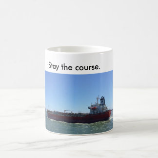 Coffee mug with ship saying stay the course.