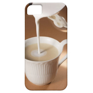 Coffee with milk being poured in iPhone 5 case