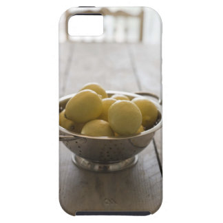 Colander with lemons on wooden table case for the iPhone 5