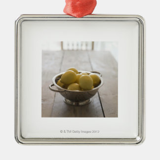 Colander with lemons on wooden table Silver-Colored square decoration