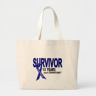 Colon Cancer 12 Year Survivor Canvas Bags