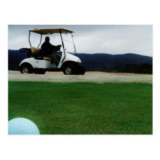 colored golf balls and cart postcard