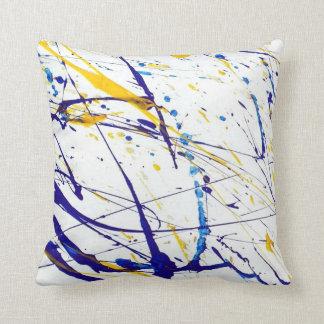 colored paint splatter pillow