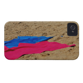 Colored towels on sandy beach iPhone 4 cover