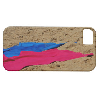 Colored towels on sandy beach iPhone 5 cover