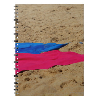 Colored towels on sandy beach spiral notebook