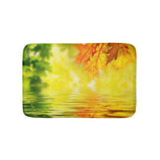 Colorful autumn leaves reflecting in the water bath mat