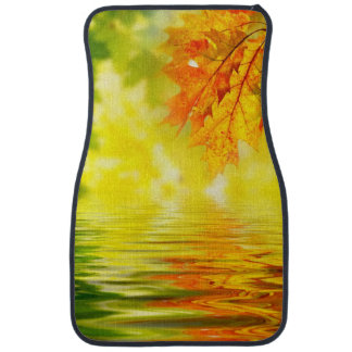 Colorful autumn leaves reflecting in the water car mat