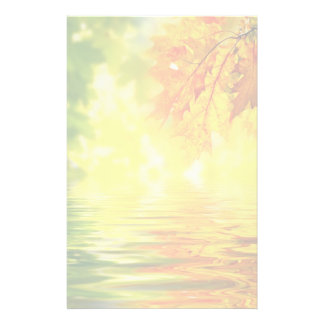 Colorful autumn leaves reflecting in the water stationery design