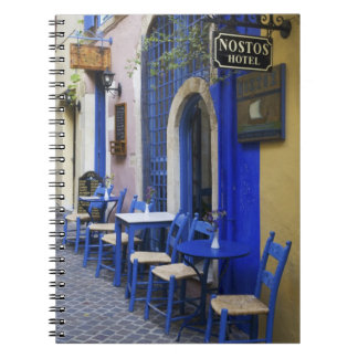 Colorful Blue doorway and siding to old hotel in Spiral Notebook