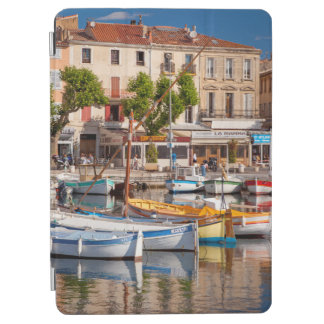 Colorful boats in the small harbor iPad air cover