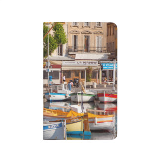 Colorful boats in the small harbor journal