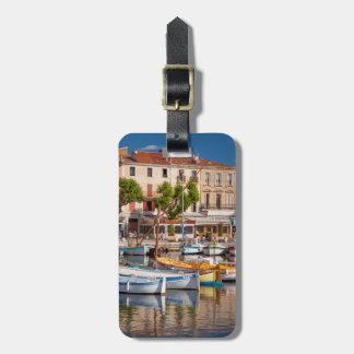 Colorful boats in the small harbor luggage tag