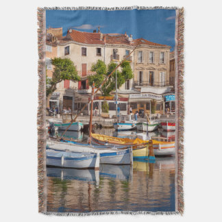 Colorful boats in the small harbor throw blanket